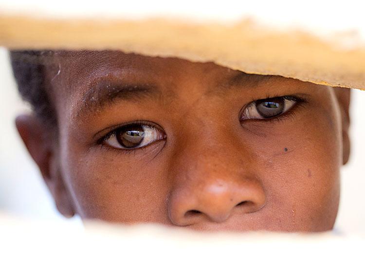 Young Haitian boy in despair after Hurricane Matthew.
