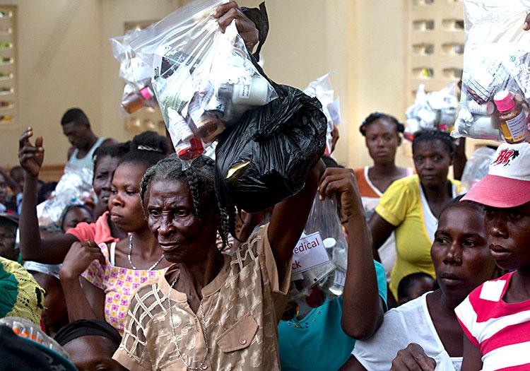 Haitian families receive Family Medical Packs.