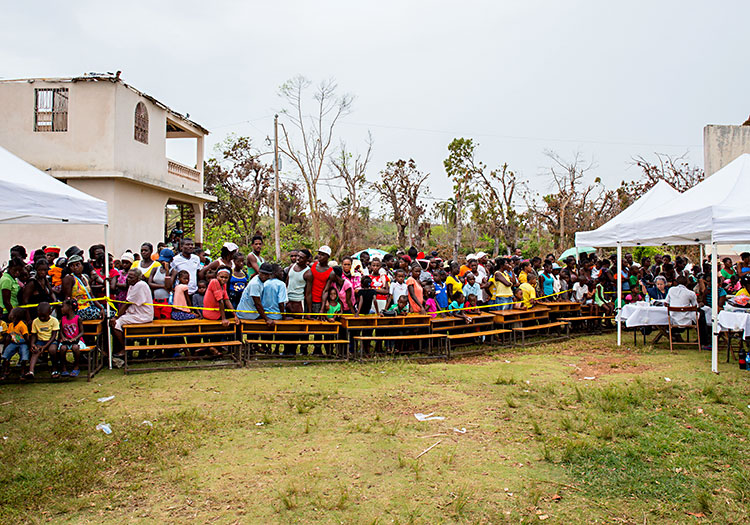 Haitians waiting in the rain for medical care.