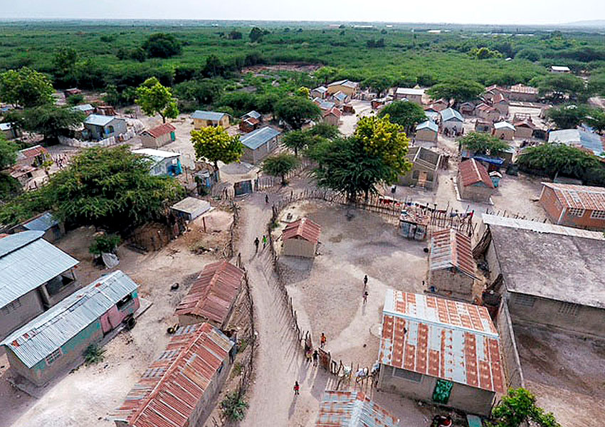 This is Chambrun, a huge Voodoo village filled with people who are dirt poor.