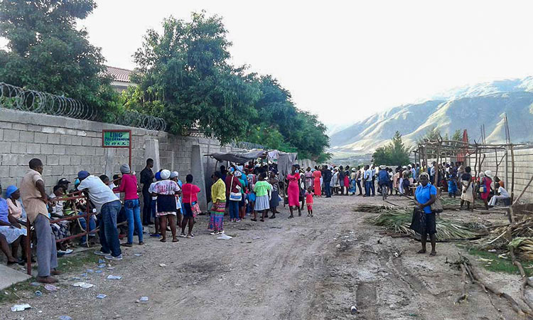 Haitians waiting outside Jesus Healing Center to see doctors.