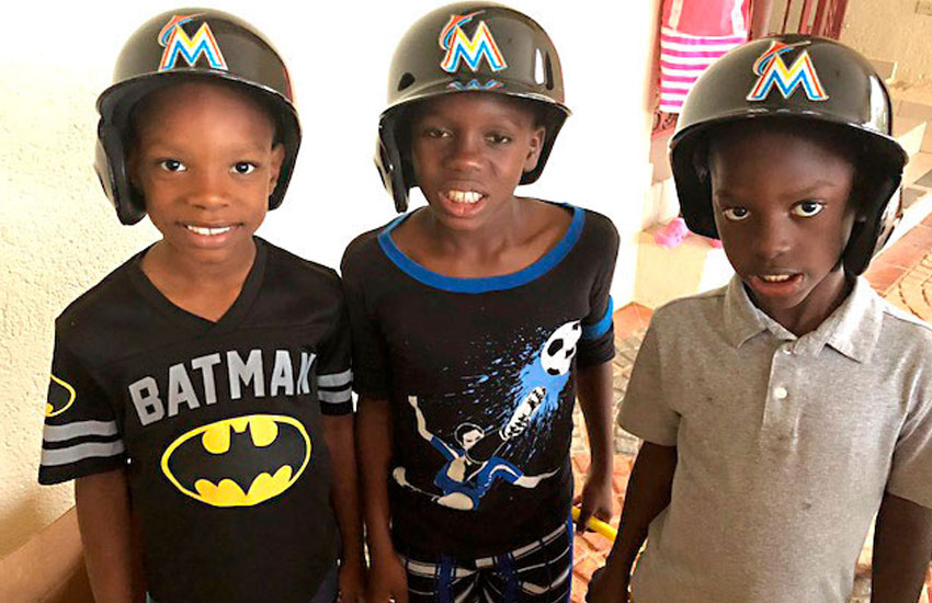 Our boys loved the baseball helmets and gear donated by Juan Lionel Garciga.