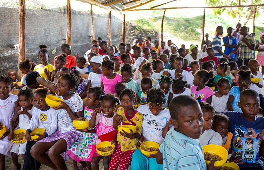 Feeding children in Fond Bayard, Haiti.