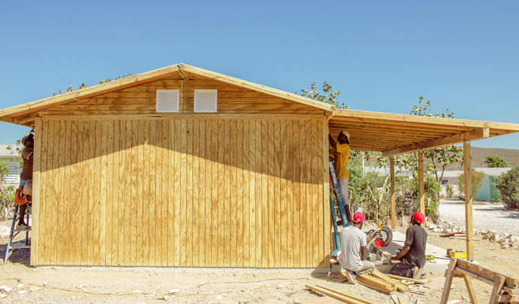 Constructing a new house in Miracle Village.