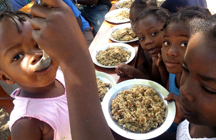 Feeding the children.