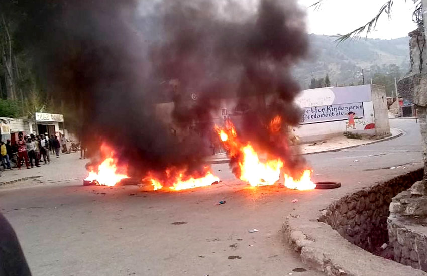 Burning tires in the streets of Haiti.