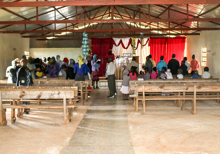The people and children are so happy with their new church! It's not finished yet…