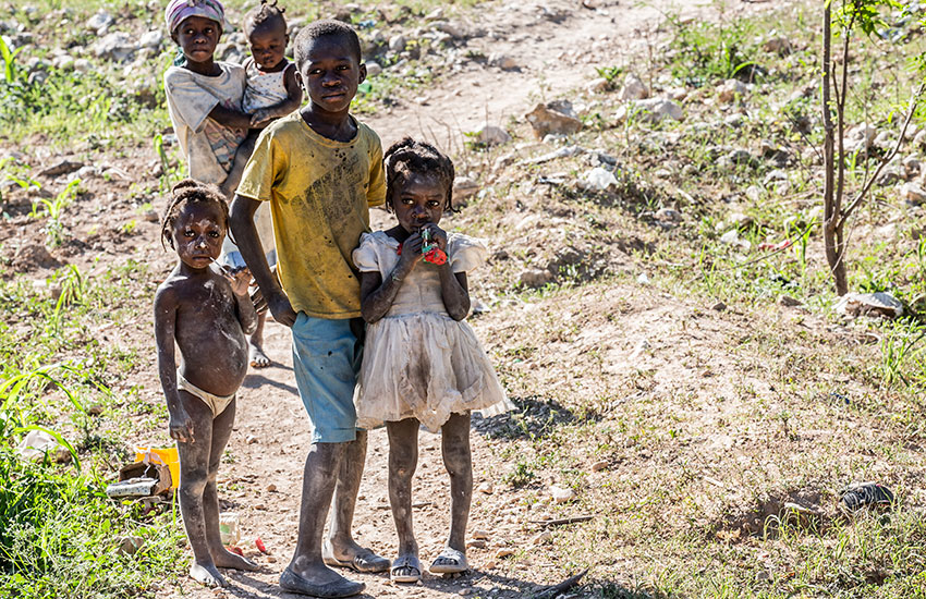 Poor children in the mountains are desperate for food and water.