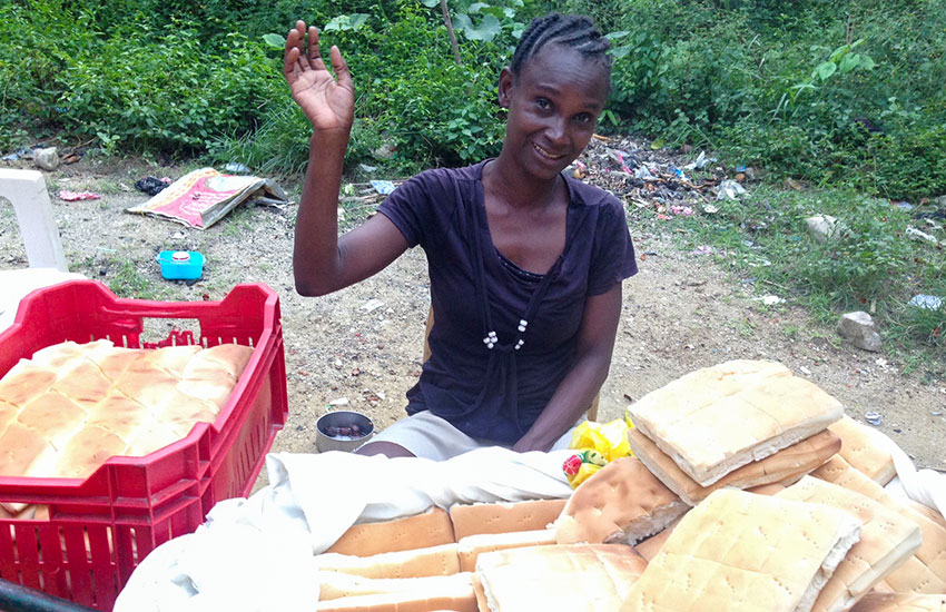 Haitian woman has a new business making and selling bread.