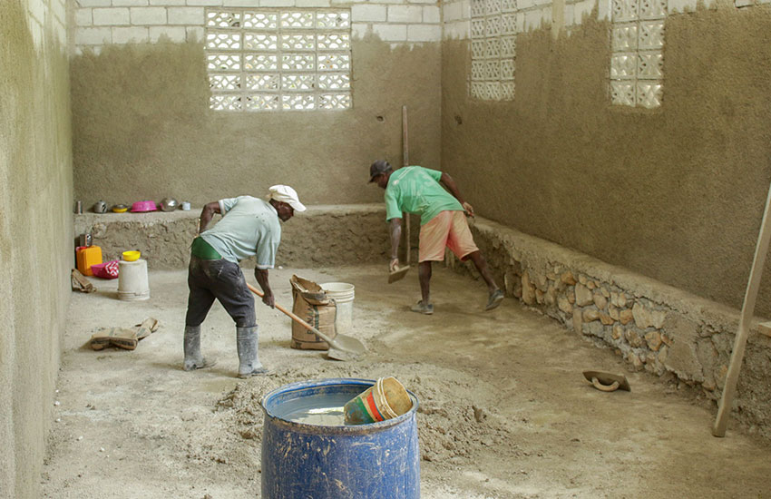 Local workers building up the inside of one of the new classrooms.