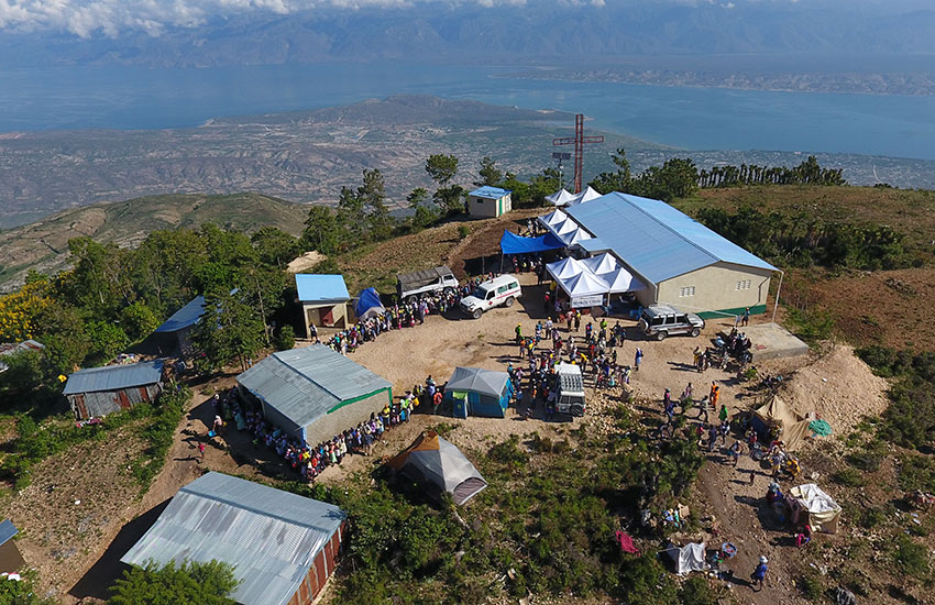 People line up for a Mobile Medical Clinic on top of the mountain in Peyi Pouri.