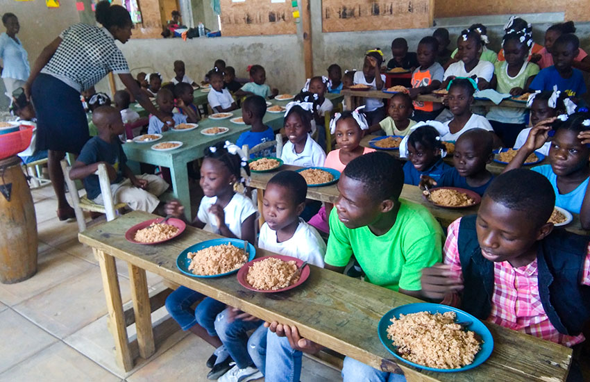 "We love ""sharing our food"" with others, like this orphanage in Haiti."