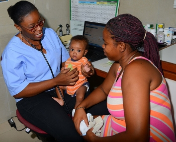 Birthing Center Nurse with an infant
