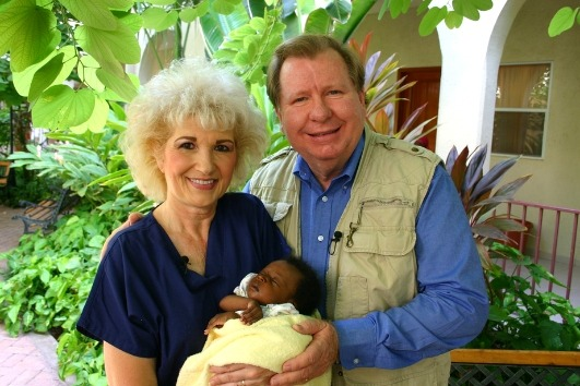 Bobby and Sherry Burnette lovingly embrace a new baby brought into the Love A Child Children's Home family