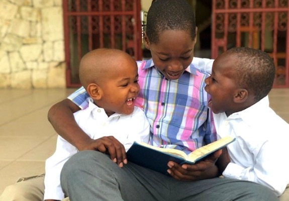 Pictured here are Samuel, Job, and Noah during their Bible reading time. Love A Child continues by faith to raise the standard of care in meeting the needs of the children we serve.