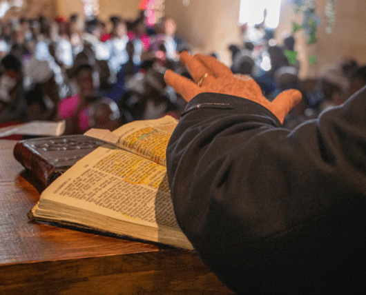 Bobby Burnette's hand on Bible from the Church pulpit in Fond Parisien, Haiti